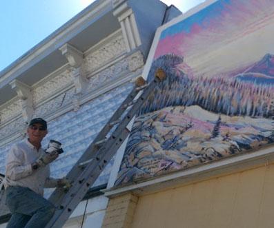 Fred Haberlein repainting murals