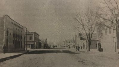 Corner of Main Street and State Avenue, about 1910, with American National Bank(left) and Emperius Building(right). Emperius Building tenant O.T. Davis Photo, No. 1121 courtesy of Alamosa Public Library.